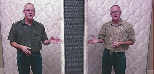 Photo of Jim King facing another Jim King talking about double sided mattresses.